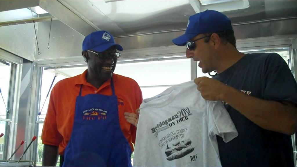 Larry Joe gets a National Hot Dog month Tour Tee Shirt